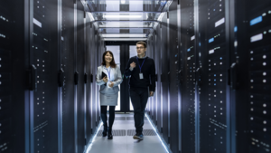two people walking through a data center