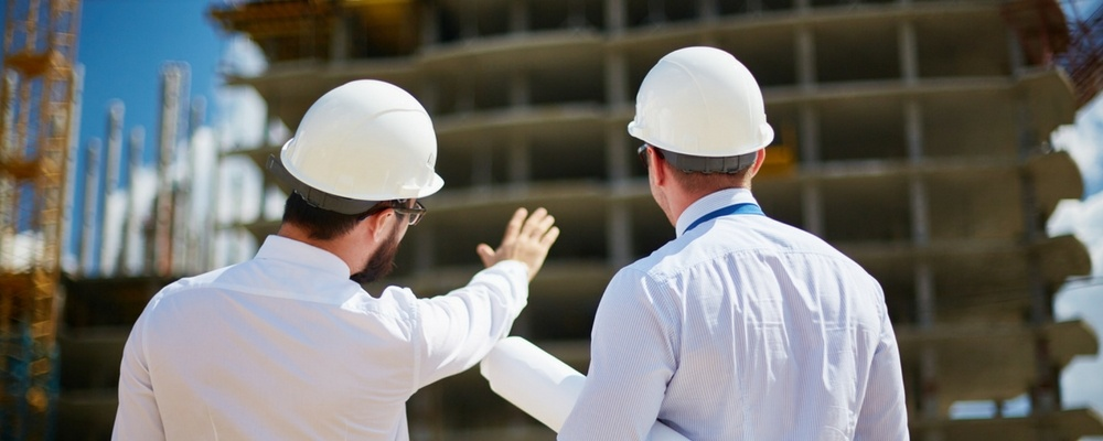 Two people with hard hats